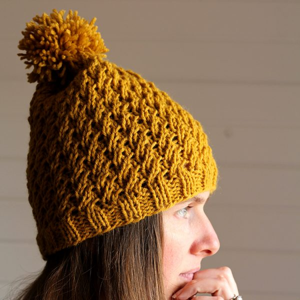 model wearing knitted hat