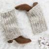 knit leg warmers on a fur blanket