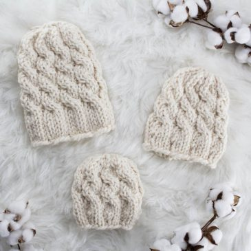 cable knit hat laying on a fur blanket