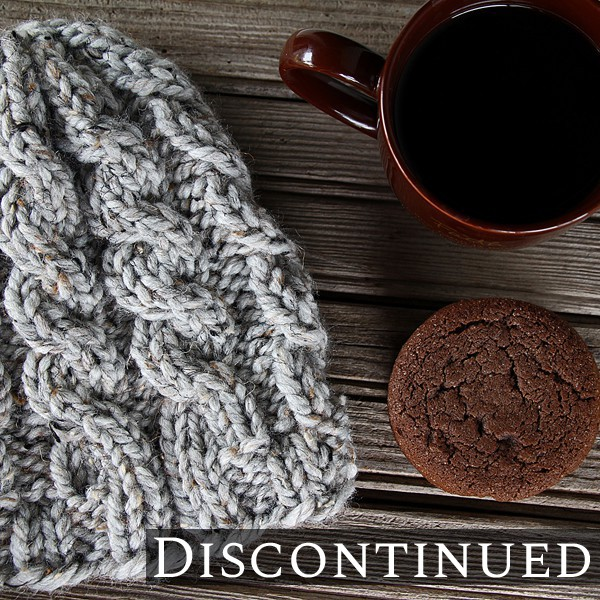 knit hat on table with cookies and coffee cup