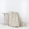 knit blanket in a basket