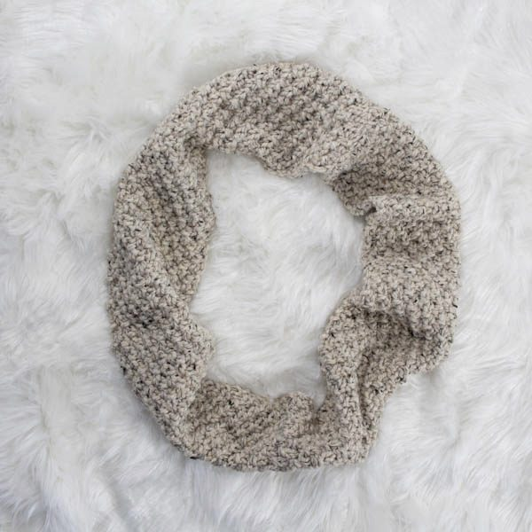 knitted cowl on a fur blanket