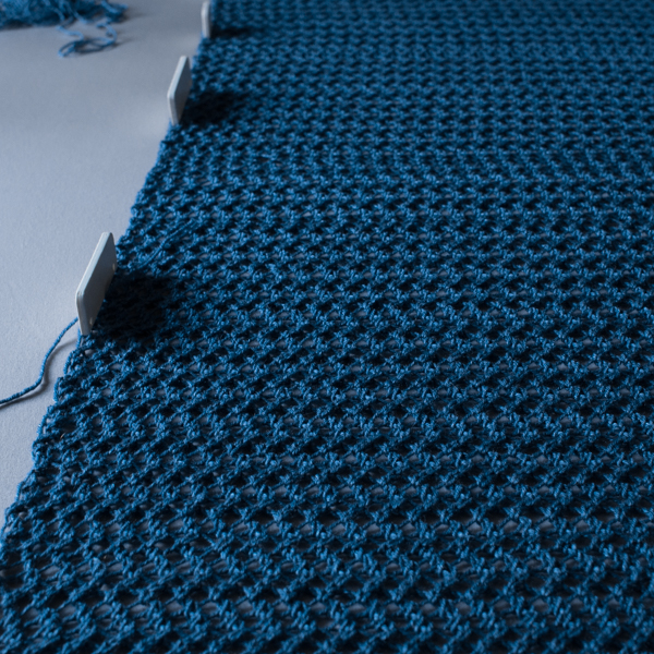 knitted blanket being blocked