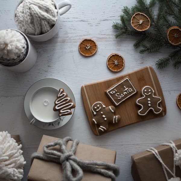 Gingerbread cookies and milk with wrapped handmade gifts.