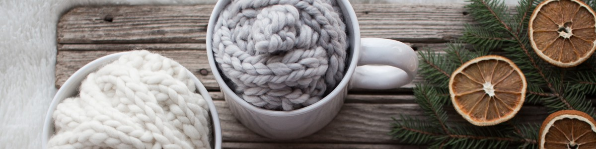 Christmas gifts of knitted headbands in large coffee mugs