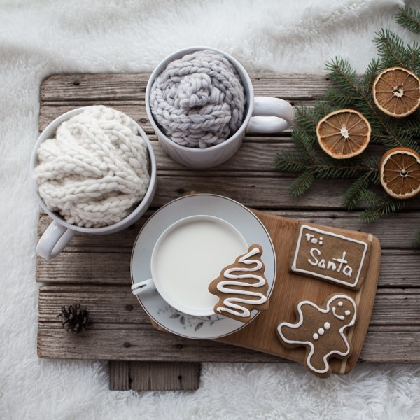 Gingerbread cookies and milk with wrapped handmade gifts. Gift wrap knits with pom-poms using leftover yarn. Super Bulky Jumbo Bow made with Lion Brands Wow yarn :) Headbands gift wrapped in a mug :)