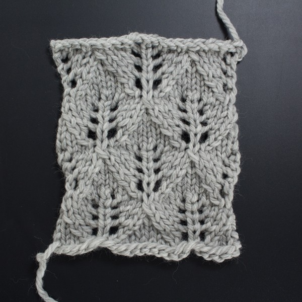 Swatch of the Front Side of the Feather Diamond Lace Knit Stitch