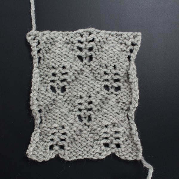 Swatch of the Back Side of the Feather Diamond Lace Knit Stitch