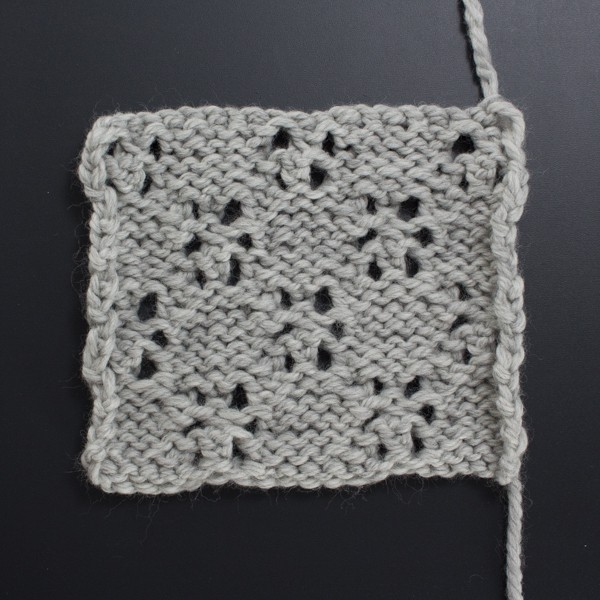 Swatch of the Back Side of the Lacy Stars Lace Knit Stitch