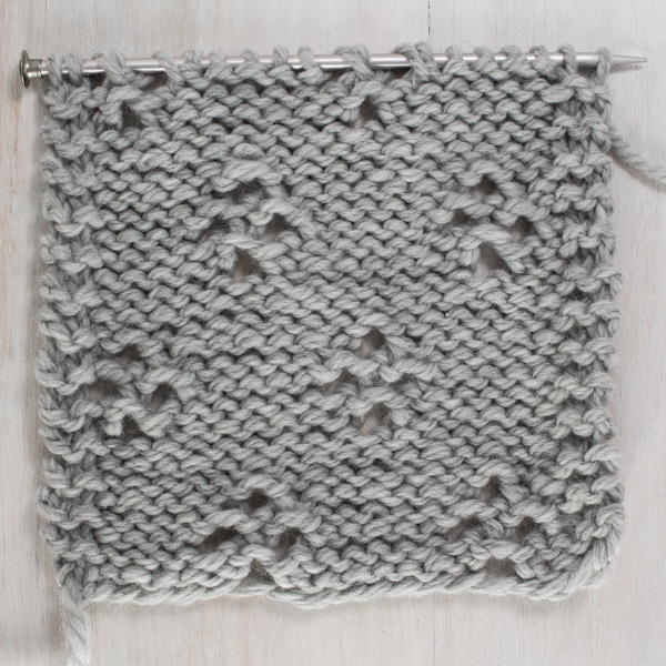 Up-close Photo of the Back Side of the Diamond Lace Knit Stitch
