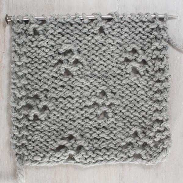 Up-close Photo of the Back Side of the Diamond Lace Knit Stitch