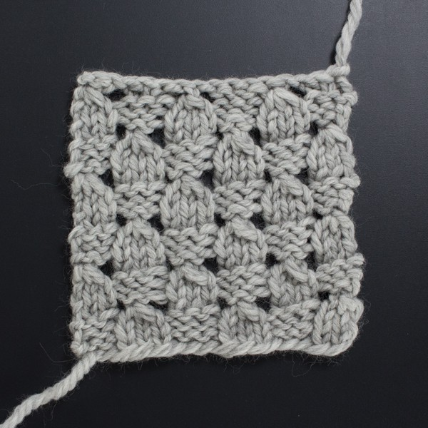 Up-close Photo of the Front Side of the Checkered Lace Knit Stitch