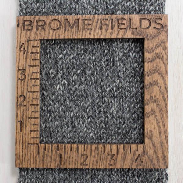 wooden gauge on scarf