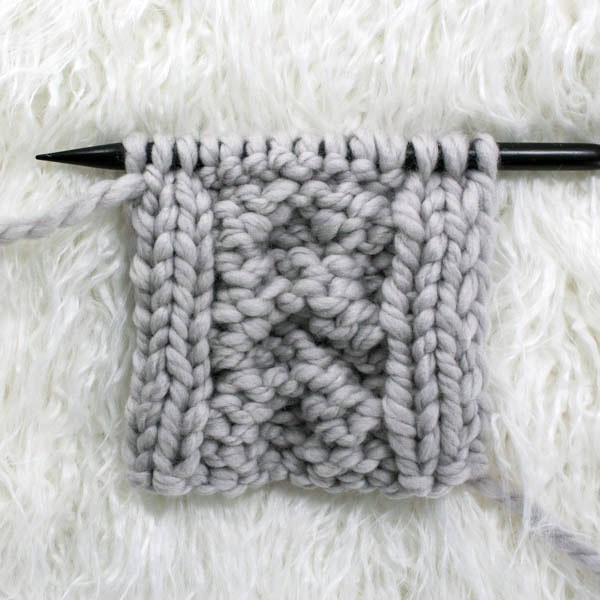 back side of swatch of cable knit stitch