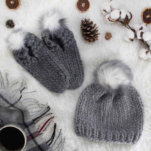 gray knit hat with fur pom