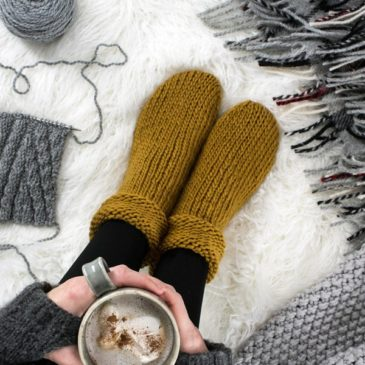 knitted socks on a fur blanket