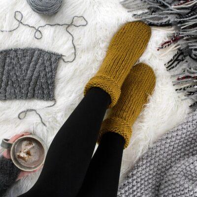 knitted socks on a fur blanket