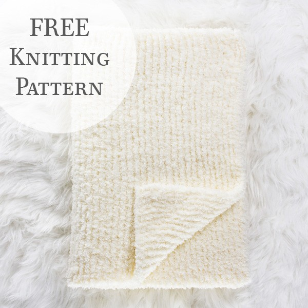 knit blanket scarf folded on a fur blanket