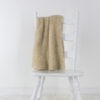 knit scarf draped over a chair