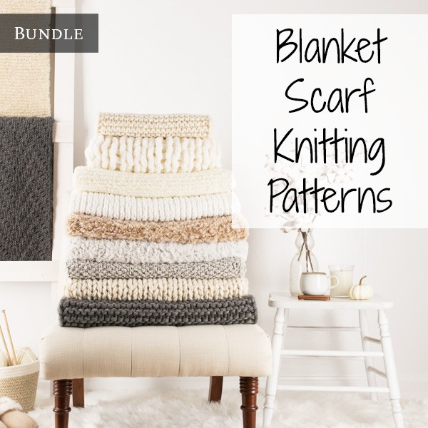 stack of knit scarves on a chair