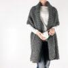 model wearing knit blanket scarf