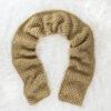 knit scarf on a rug
